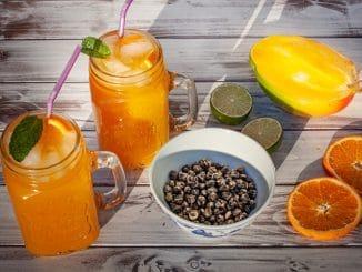 Jasmintee mit Mango, Orange und Limette