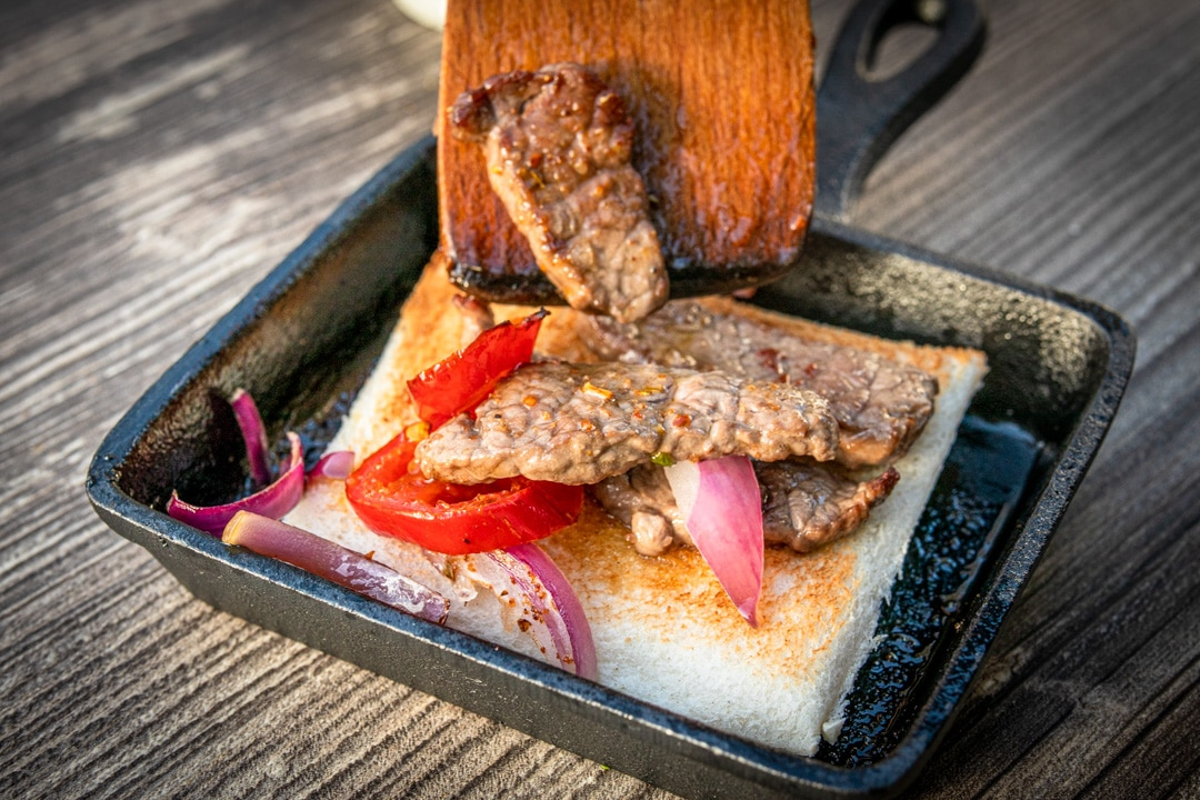Raclette mit Steakstreifen